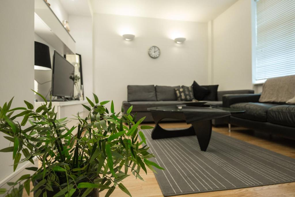 A seating area at Excel Apartments Strand