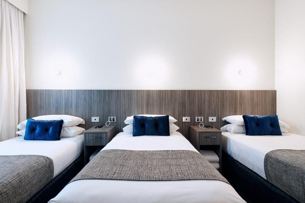 A bed or beds in a room at Club Laverton