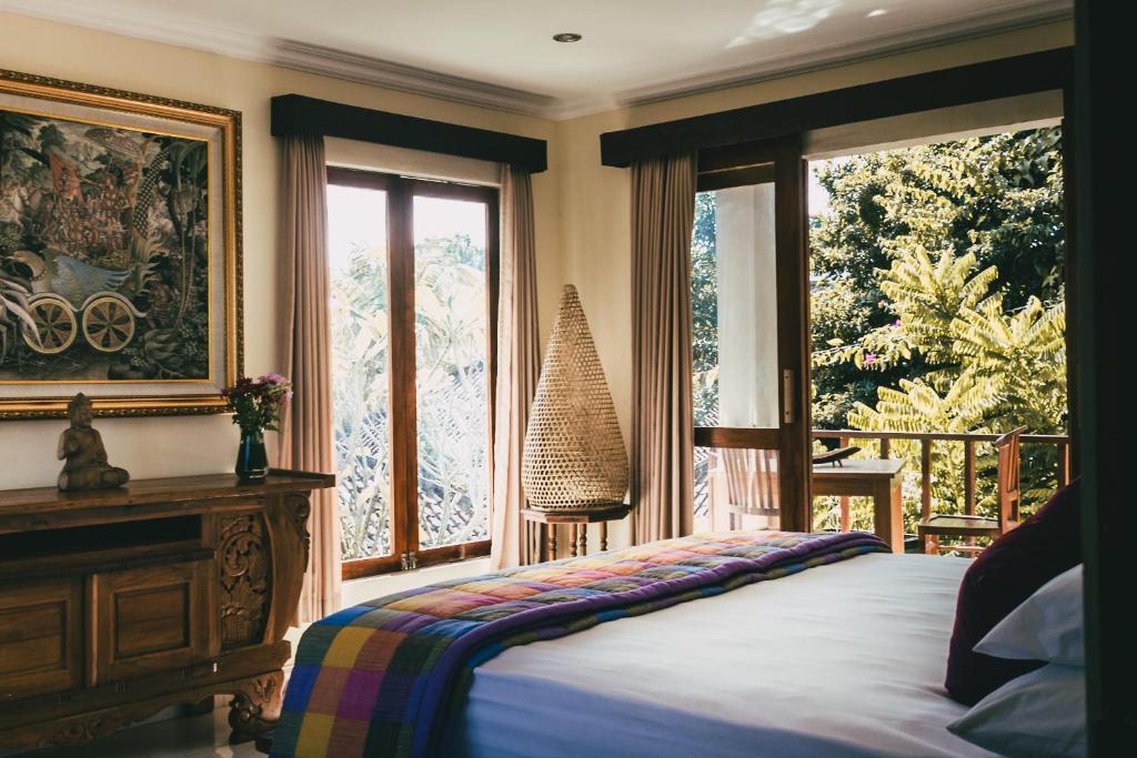 Cama ou camas em um quarto em Widi Villas