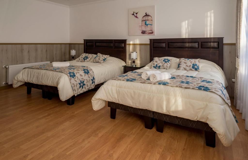 A bed or beds in a room at Hotel Borde Rio