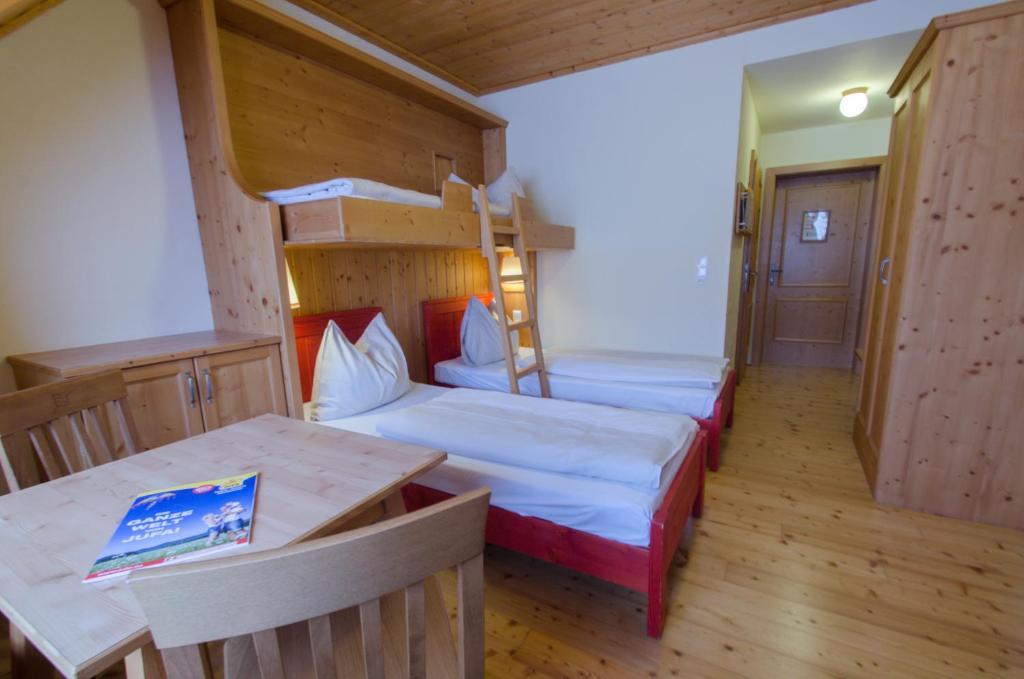 A bed or beds in a room at JUFA Hotel Tieschen - Bio Landerlebnis