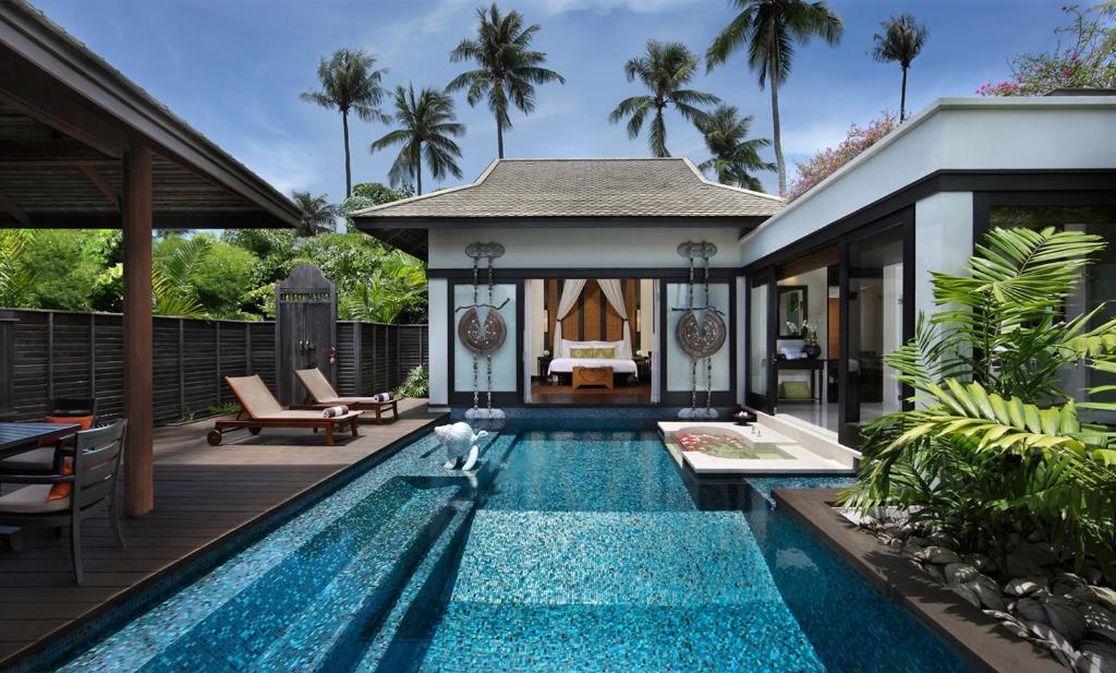 The swimming pool at or near Anantara Mai Khao Phuket Villas