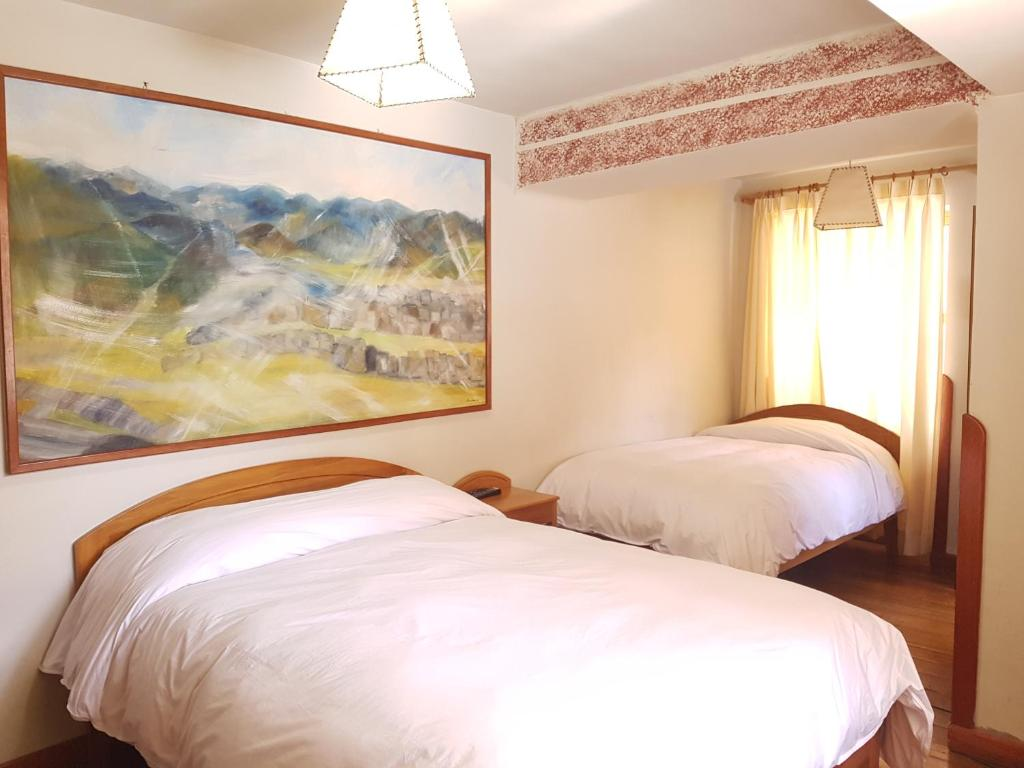 Cama o camas de una habitación en Hostal Andenes de Saphi