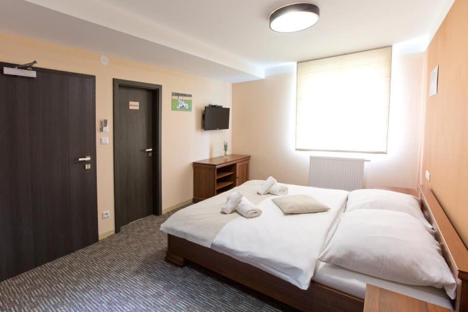Postel nebo postele na pokoji v ubytování Reštaurácia GÓL