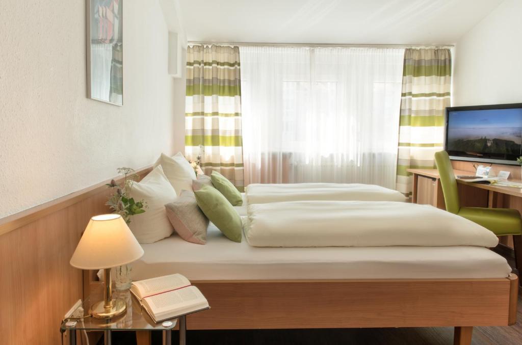 Cama o camas de una habitación en Business Hotel Böblingen-Sindelfingen