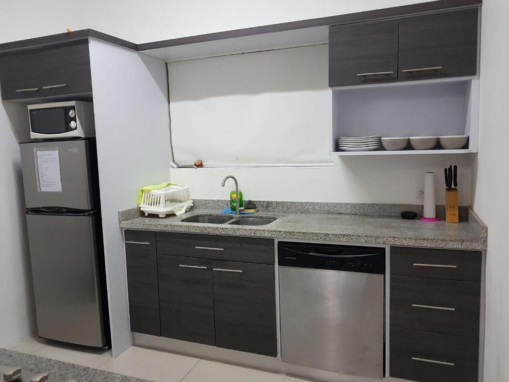 A kitchen or kitchenette at Aruba Dream House
