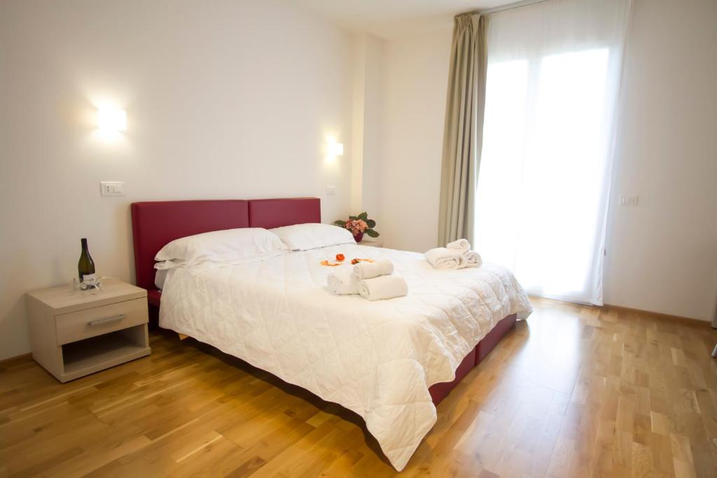 Cama ou camas em um quarto em Arezzo Sport College Hotel