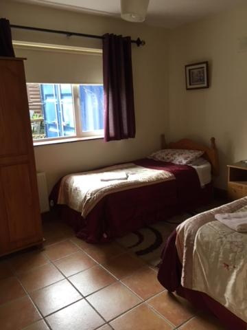 A bed or beds in a room at dublin airport apartment