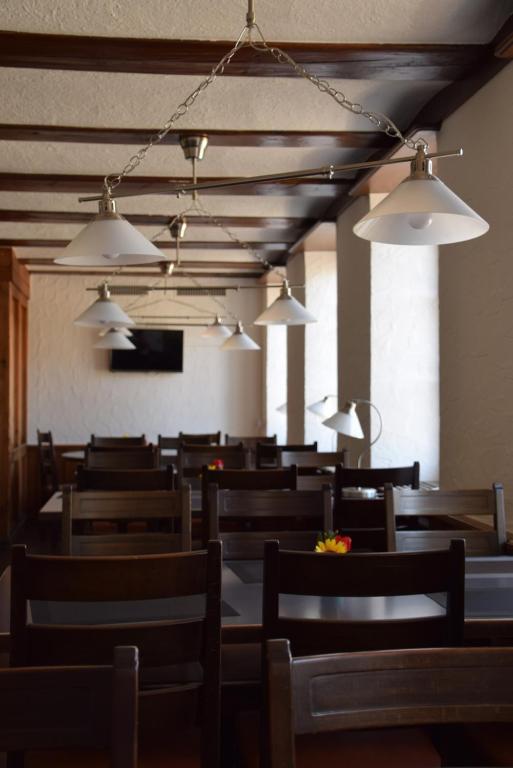 Ein Restaurant oder anderes Speiselokal in der Unterkunft Hotel-T8