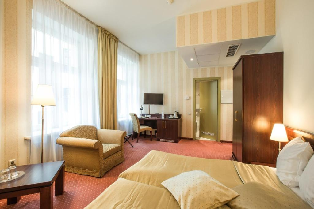 Televizorius ir (arba) pramogų centras apgyvendinimo įstaigoje Monika Centrum Hotels