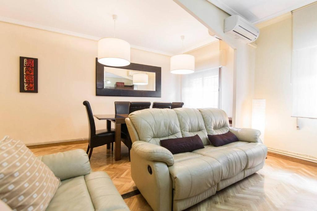 A seating area at Home & Private Terrace WIFI + AIRCON