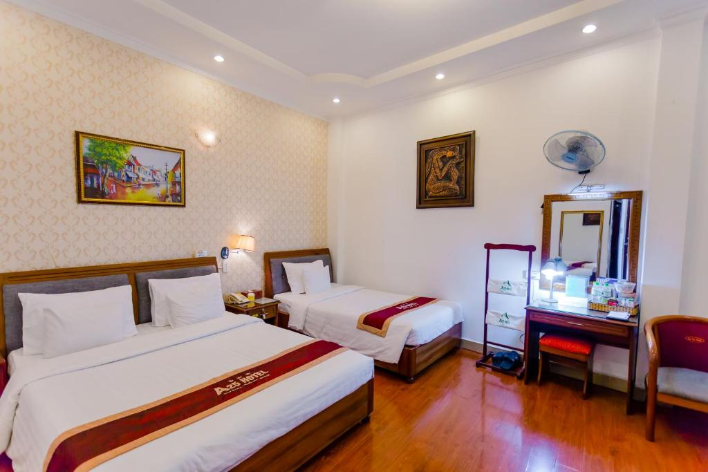 A bed or beds in a room at A25 Hotel Le Lai