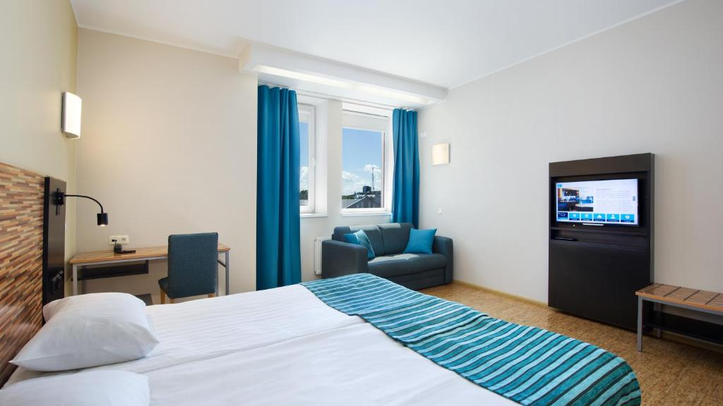A bed or beds in a room at Hestia Hotel Seaport