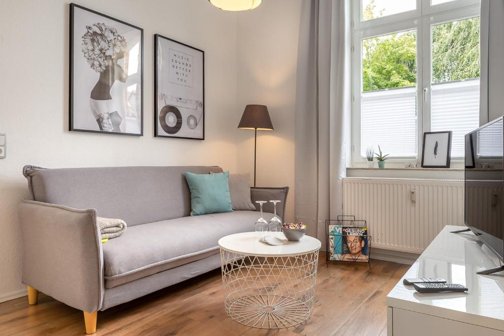 A seating area at Renoviertes Apartment mit Netflix & Boxspringbett
