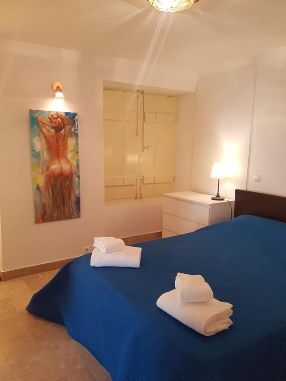 A bed or beds in a room at Casa Visconde de Alcácer