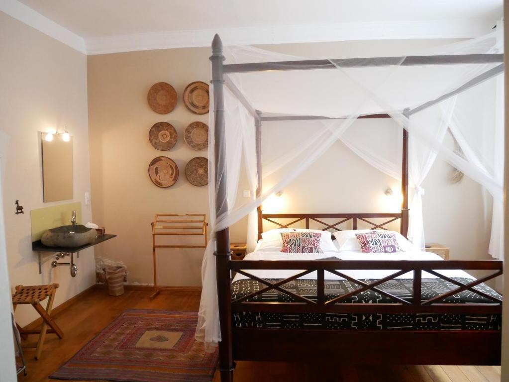 Ein Bett oder Betten in einem Zimmer der Unterkunft Bed & Breakfast Sahara