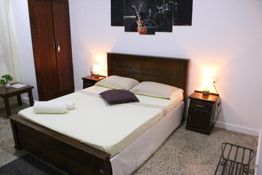 A bed or beds in a room at Angels Negombo