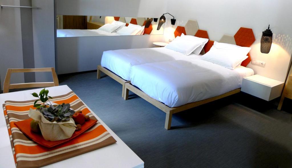 Een bed of bedden in een kamer bij Blanco Apartamentos Turísticos