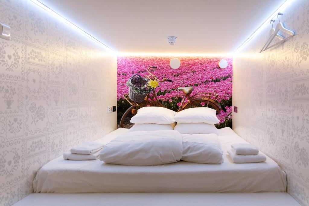 Кровать или кровати в номере De Bedstee Boutique Capsules