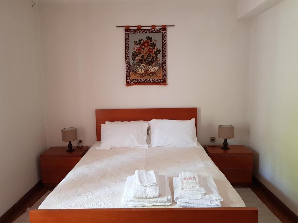 A bed or beds in a room at Casa da Piedade, Vouzela