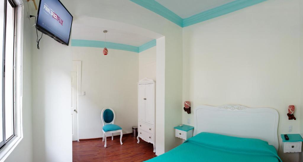 Cama o camas de una habitación en Hostal Casa Aborigen