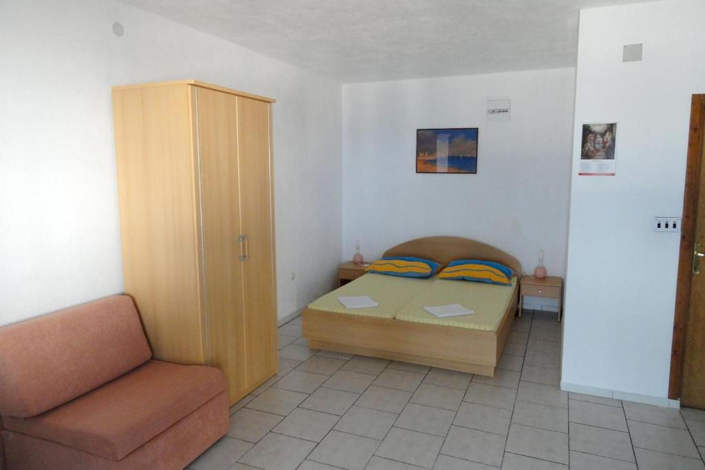 A bed or beds in a room at Studio Businci 11232c