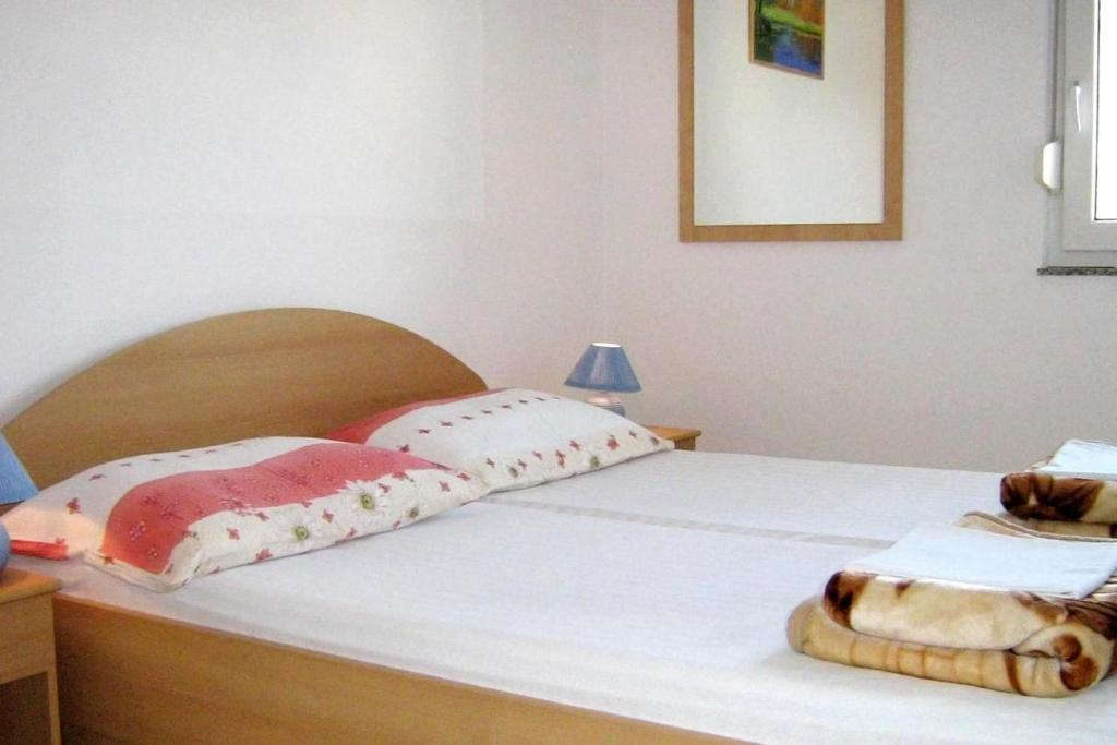 A bed or beds in a room at Apartment Businci 11232a