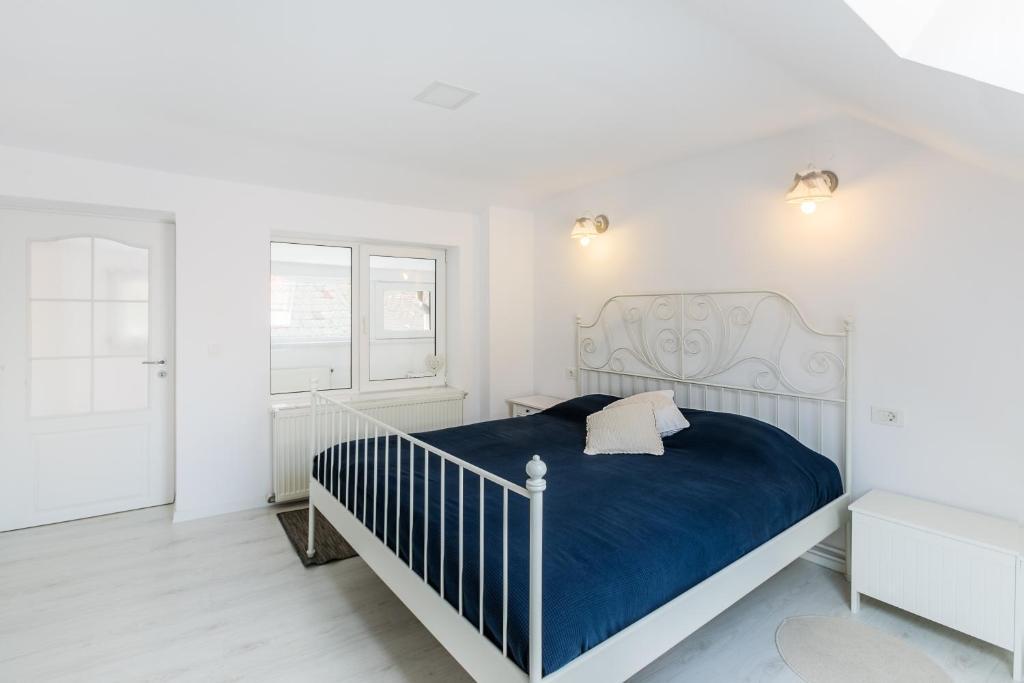 Cama ou camas em um quarto em Kendall Studio