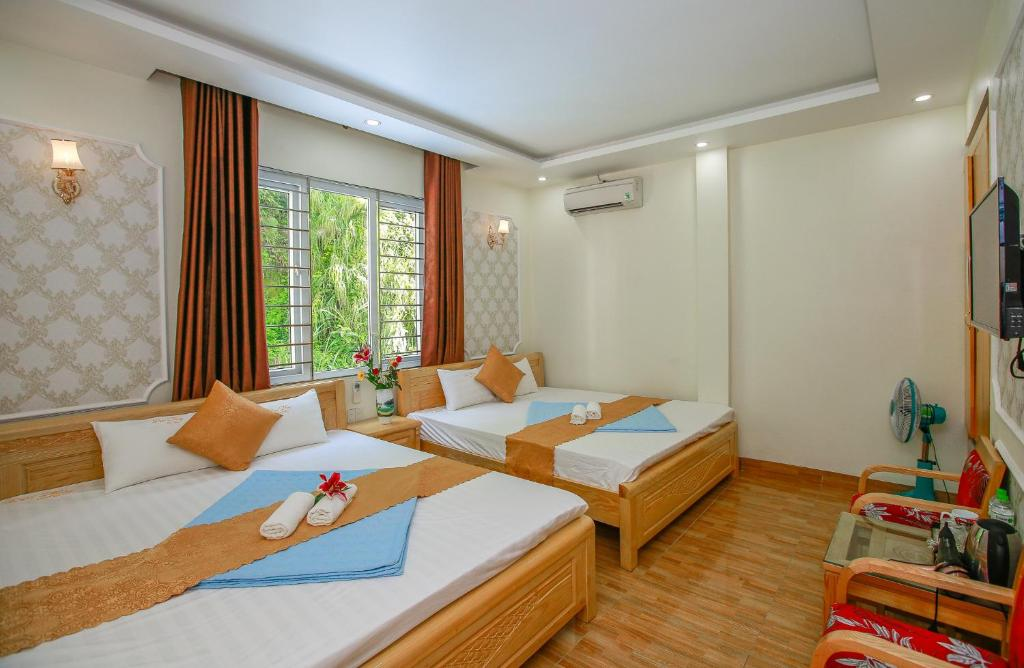 A bed or beds in a room at CatBa Lucky Family Hotel