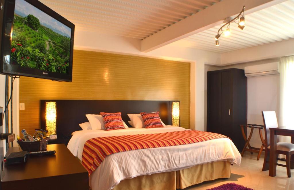 Кровать или кровати в номере Hotel Tangara