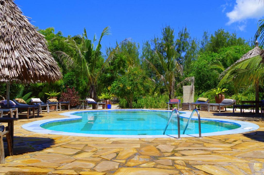 The swimming pool at or near Mbuyuni Beach Village