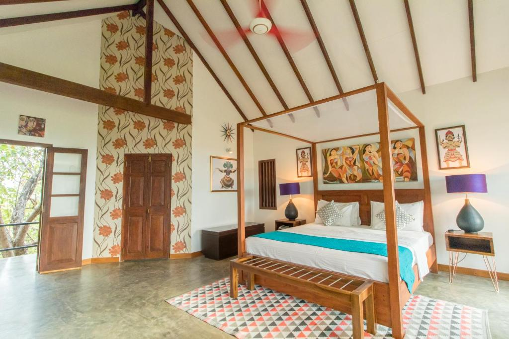 A bed or beds in a room at Elephant Stables Dambulla