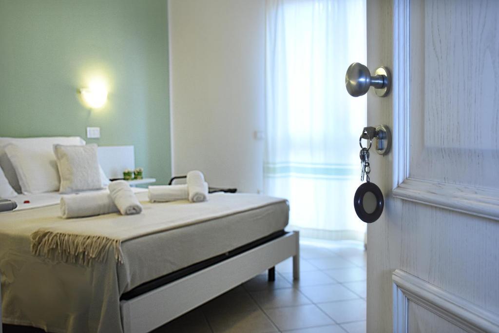 Cama o camas de una habitación en Hotel Stella D'Oro