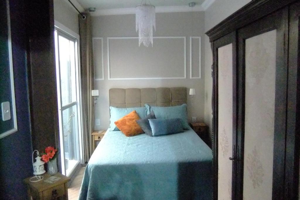 A bed or beds in a room at Apartamento Requintado no Gasômetro