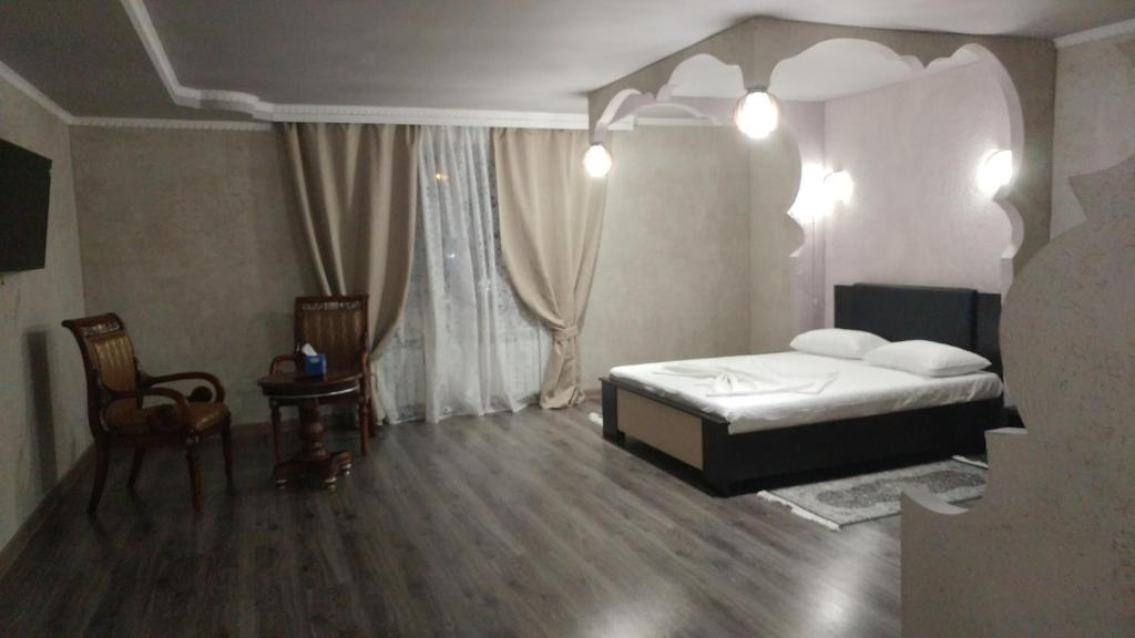 Кровать или кровати в номере Hotel Van