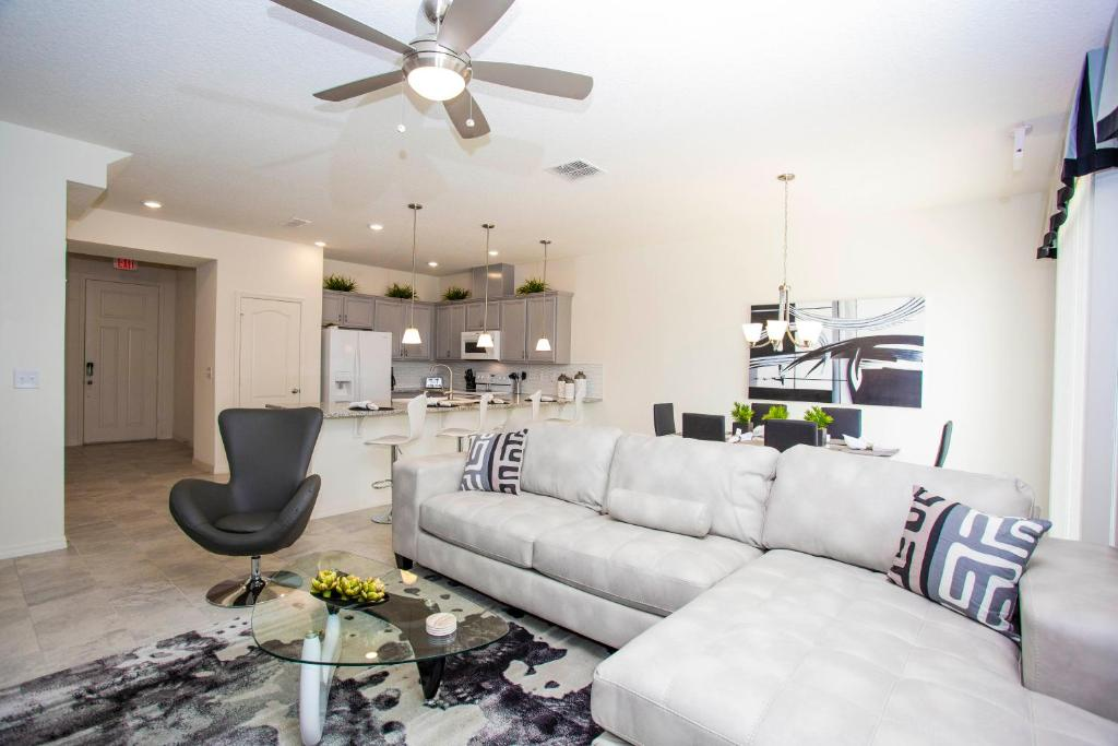A seating area at Four Bedroom Close to Disney 5149A