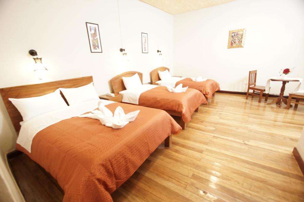 Cama o camas de una habitación en Kusipaqari Hotel