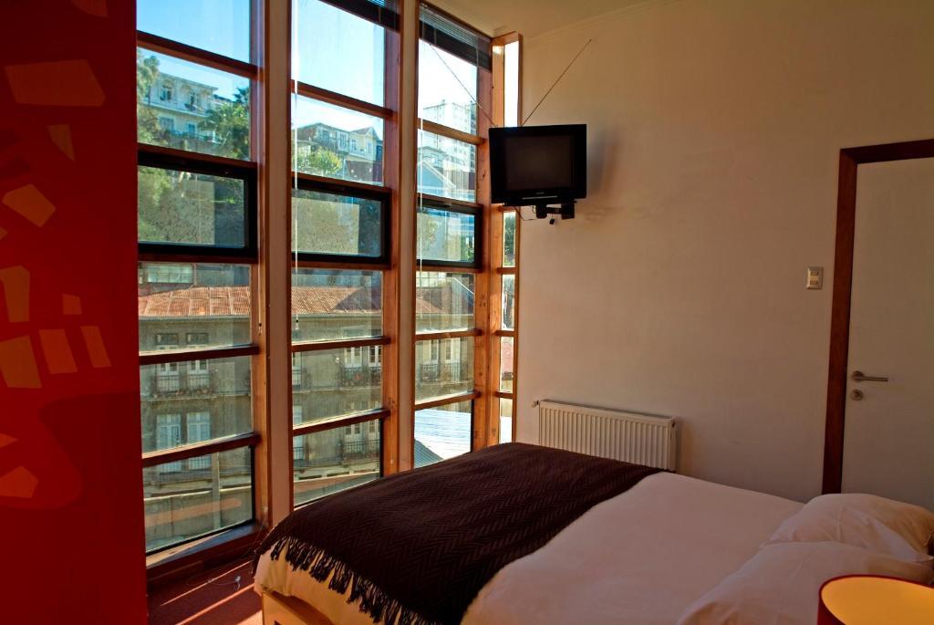 Cama o camas de una habitación en Hotel Latitud 33º Sur