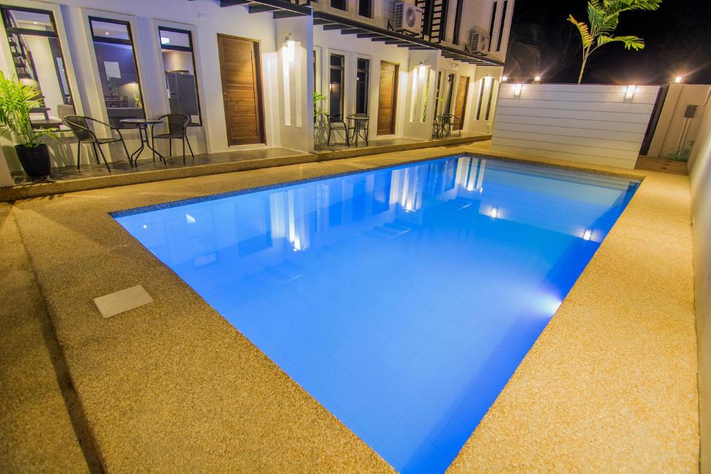 The swimming pool at or near Quest Villa
