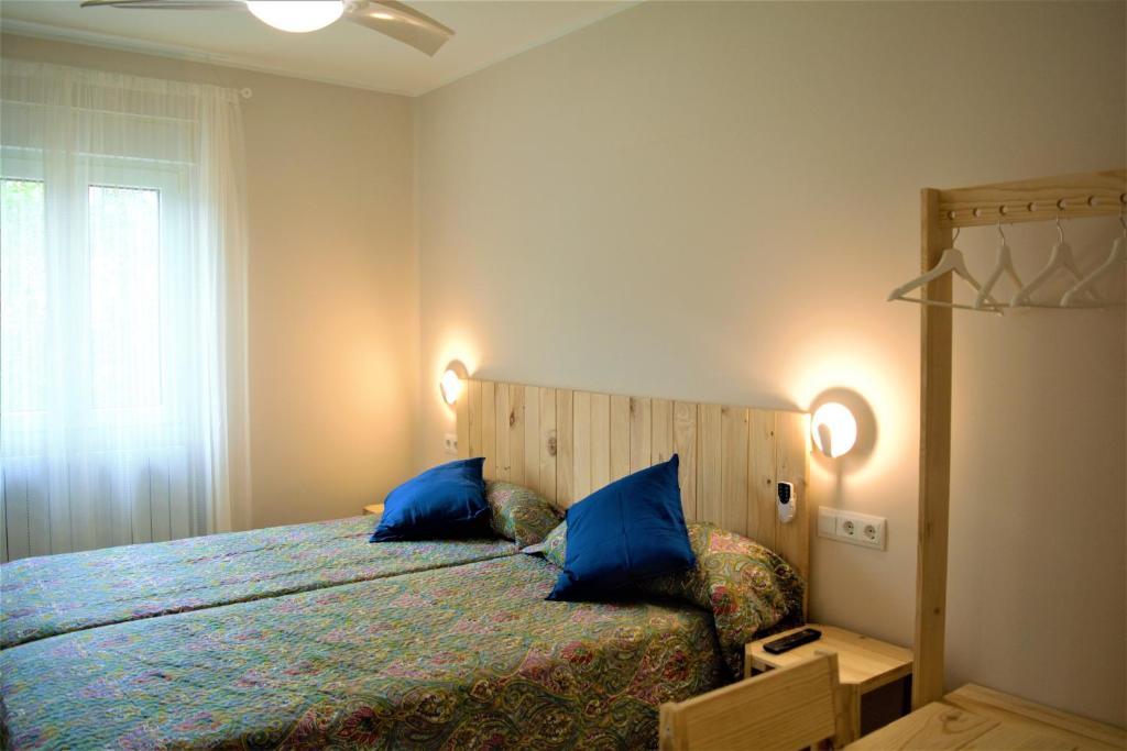 Cama o camas de una habitación en B&B LOS LLANOS