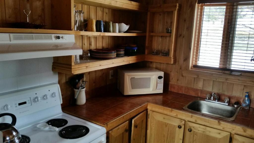 A kitchen or kitchenette at Chalets de l'Anse Ste Helene