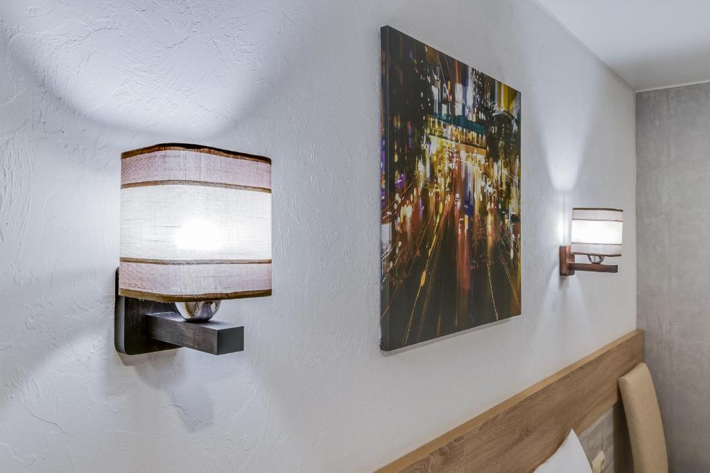 Телевизор и/или развлекательный центр в Hotel Welcome inn