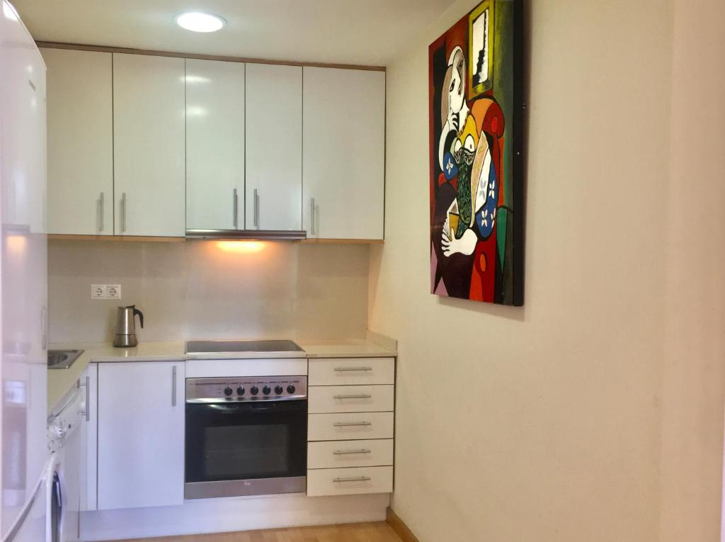 A kitchen or kitchenette at City Center Apartments Barcelona