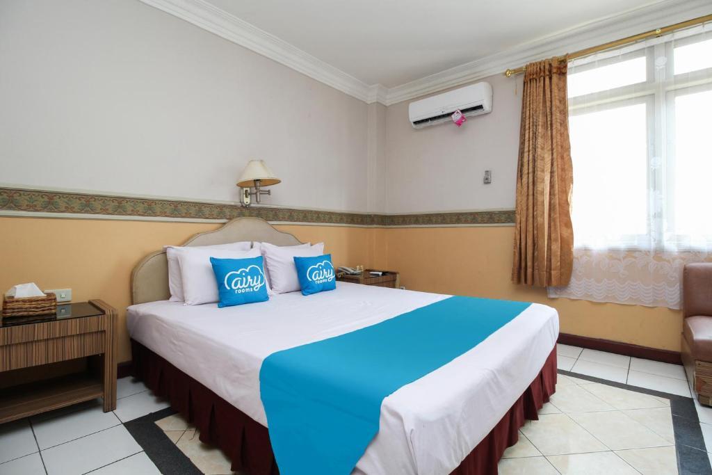 Tempat tidur dalam kamar di Airy Tanjung Karang Raden Intan 114 Bandar Lampung