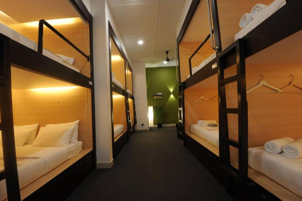 A bunk bed or bunk beds in a room at Star Anise Boutique Capsules