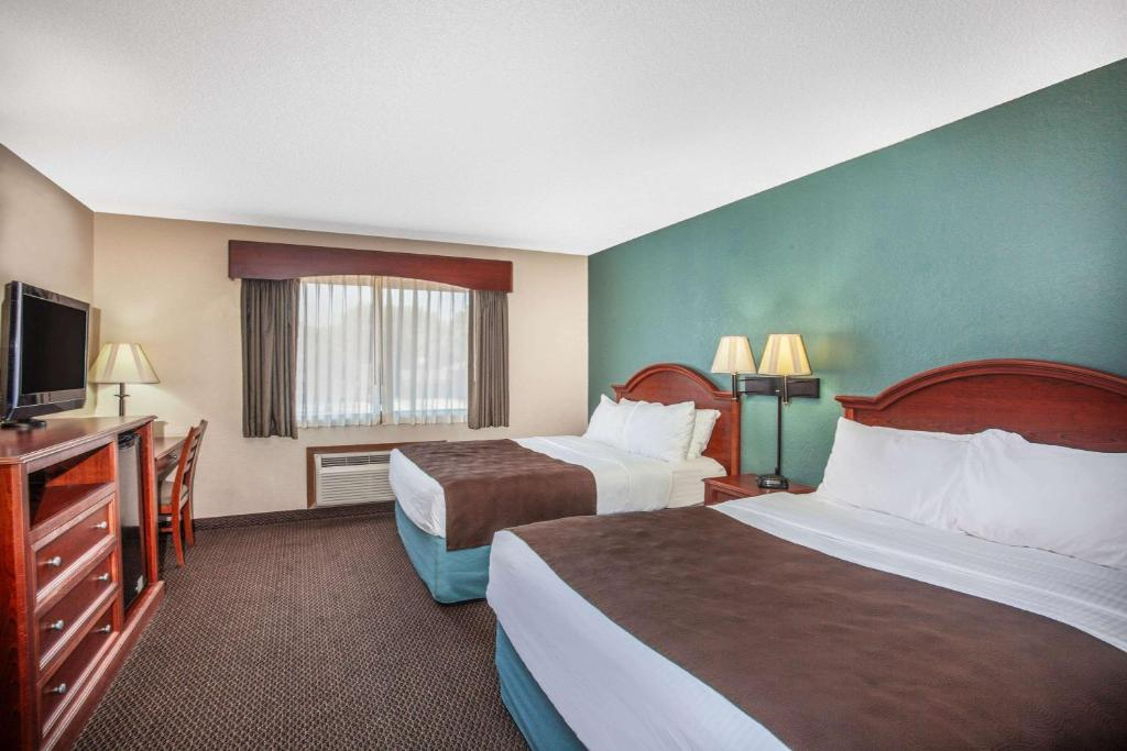 A bed or beds in a room at AmericInn by Wyndham St. Peter