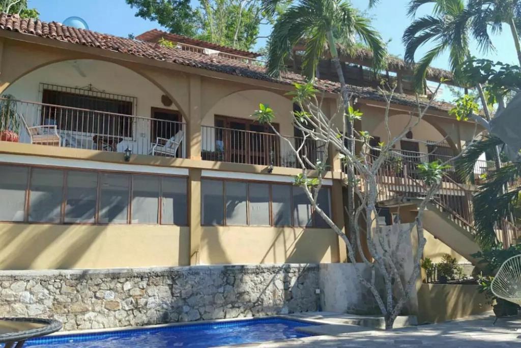 The swimming pool at or near Casa Maria en La Manzanilla