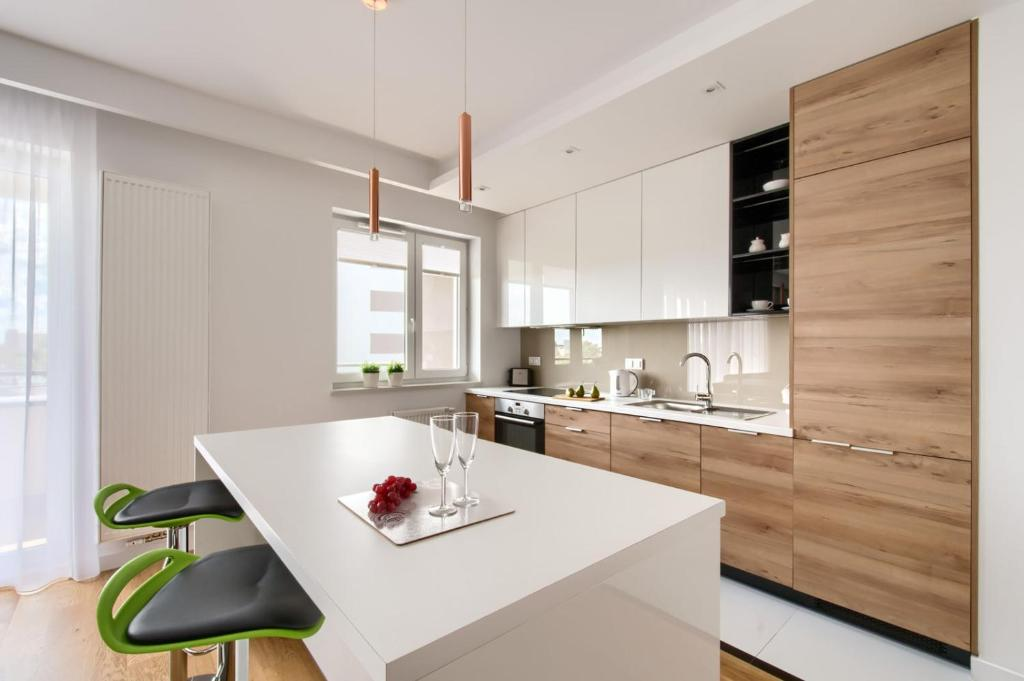 Virtuvė arba virtuvėlė apgyvendinimo įstaigoje P&O Apartments Mokotów