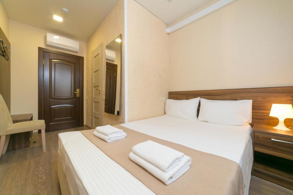 Кровать или кровати в номере Бутик-отель на Мукомольном