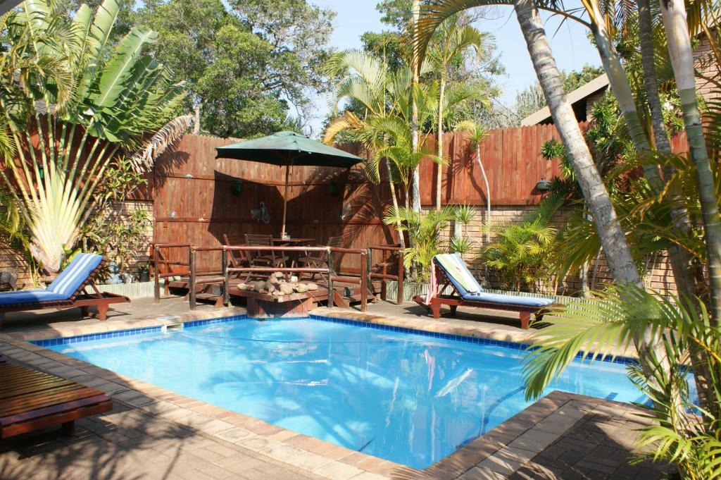 The swimming pool at or near Bhangazi Lodge Bed & Breakfast